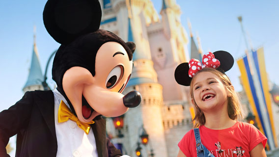 Little girl with gold ears at Magic Kingdom