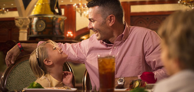 Family enjoying a meal at Be Our Guest Restaurant in Magic Kingdom