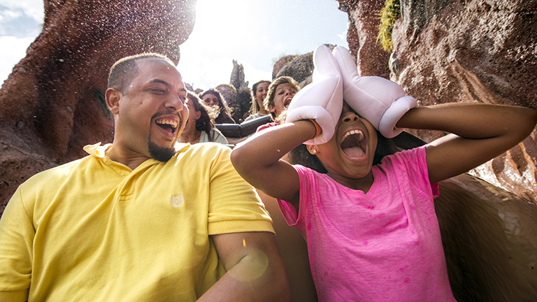 Father and daughter on Splash Mountain in Magic Kingdom