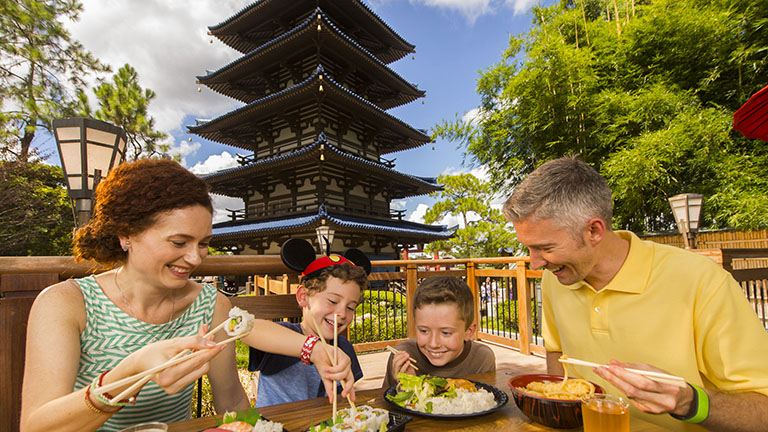 Family enjoying sushi at Epcot's World Showcase, Japan