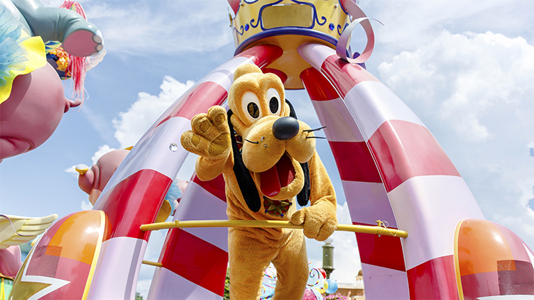 Pluto in Festival of Fantasy at Magic Kingdom