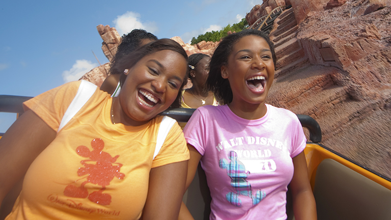 Teenage girls on Big Thunder Mountain Railroad in Magic Kingdom