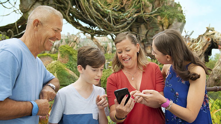 Family using the My Disney Experience app at Disney's Animal Kingdom Theme Park