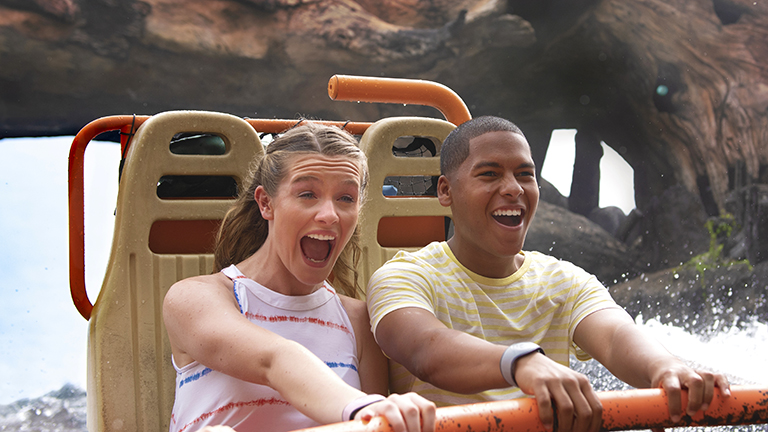 Teenagers on Kali River Rapids at Disney's Animal Kingdom Theme Park