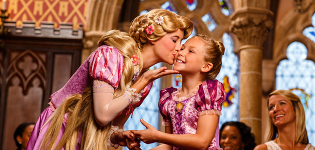 Girl with Rapunzel at Cinderella's Royal Table.
