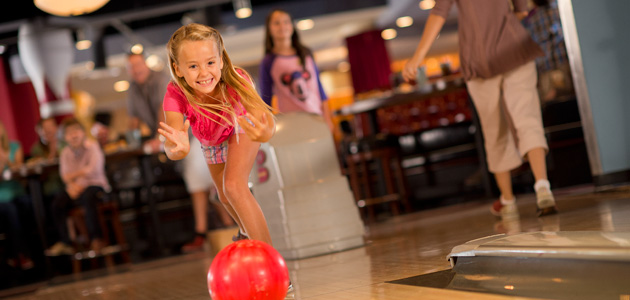 Young girl enjoys bowling at Splitsville Luxury Lanes