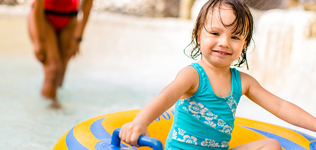 Young girl playing at Ketchakiddee Creek at Disney's Typhoon Lagoon.