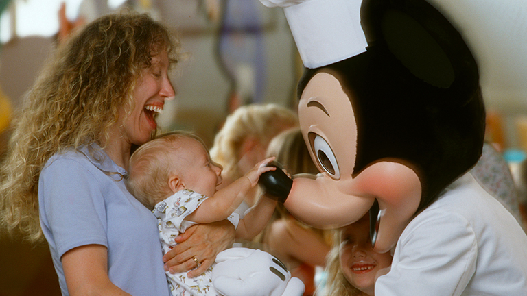 Mother and baby meeting Mickey Mouse at Character Dining