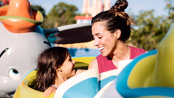 Young guest with mum on Dumbo The Flying Elephant