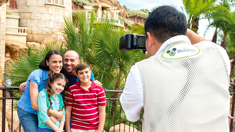 Family taking advantage of Memory Maker, having their photo taken by a Disney PhotoPass Photographer