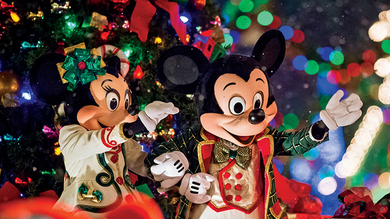 Mickey and Minnie Mouse looking festive at Mickey's Very Merry Christmas Party